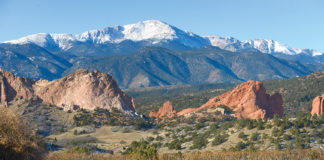 Pikes Peak and Garden of the Gods beyond the Garden fo the Gods Club and Resort infinity pool.