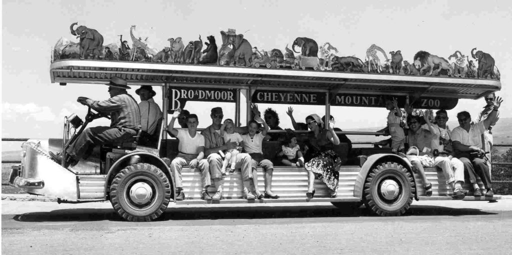1950s zoomobile with passengers