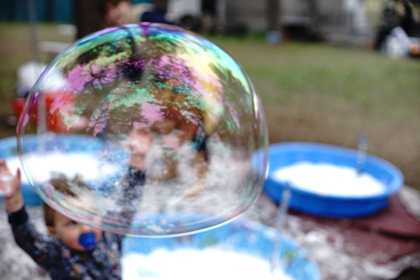 bubble and child at MeadowGrass