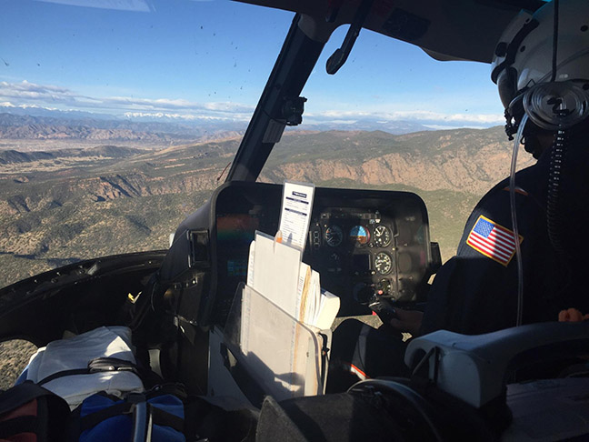 Shawn McFarland pilots a helicopter.