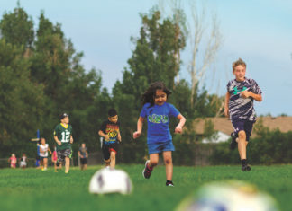 kids play soccer with sessi