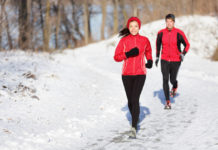 runners on winter trail