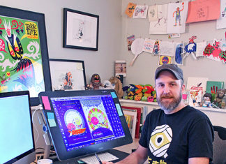 illustrator and author Luke Flowers in his office