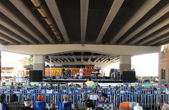 train behind stage at blues under the bridge