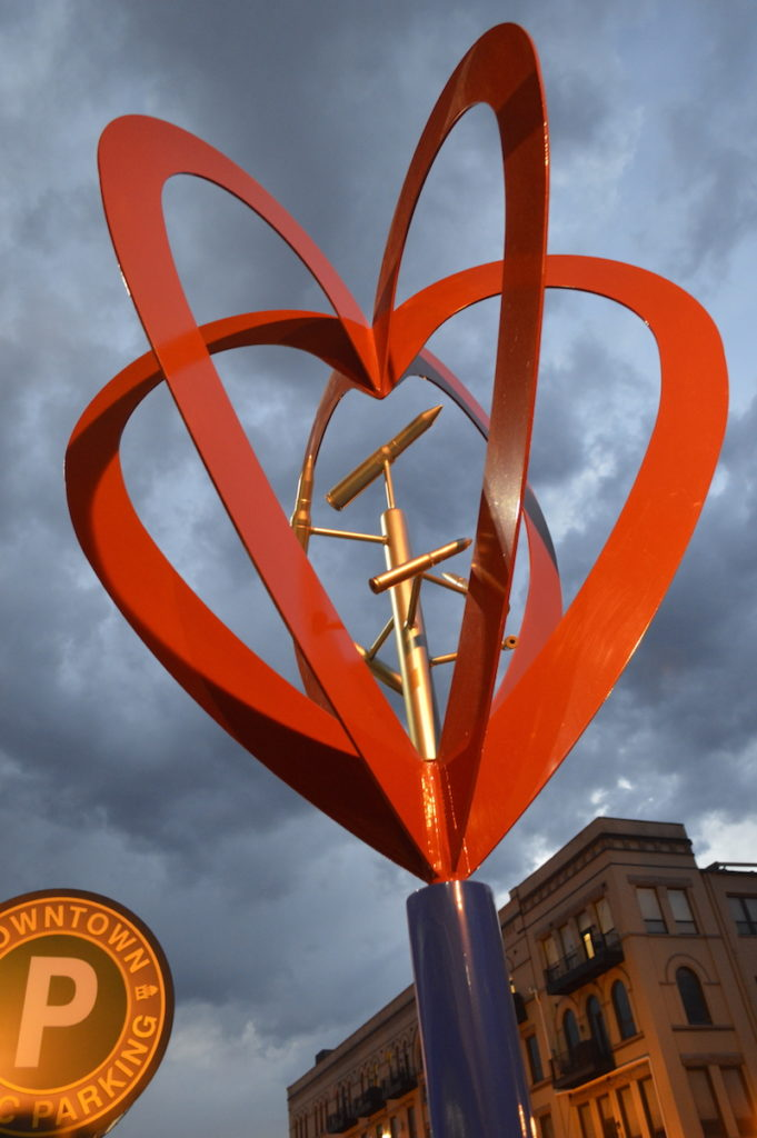 love is the answers sculpture in art on the streets
