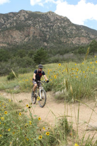 mountain biker at cheyenne mountain state park