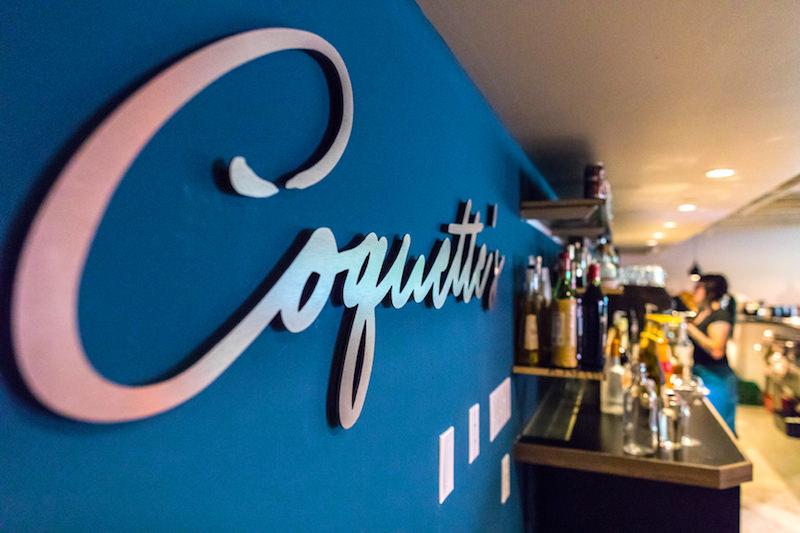 sign inside coquette's bistro