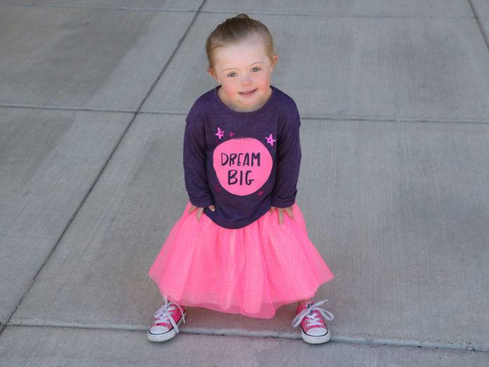Girl posing for Rick Guidotti at Positive Exposure