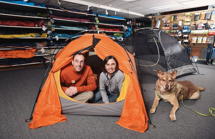 mountain chalet owners jim and plaine smith in tent