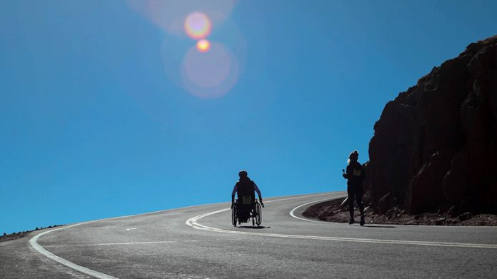 dr. house rolls his wheelchair up pikes peak