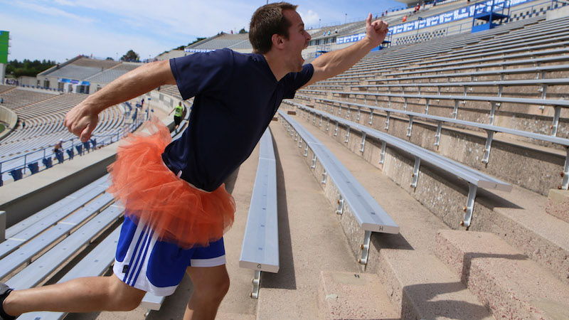 man in tutu on the stairs for Climb for Courage