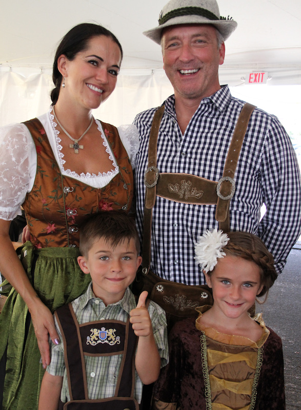 family in traditional bavarian garb