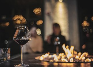 cozy hideaways wine glass and fire