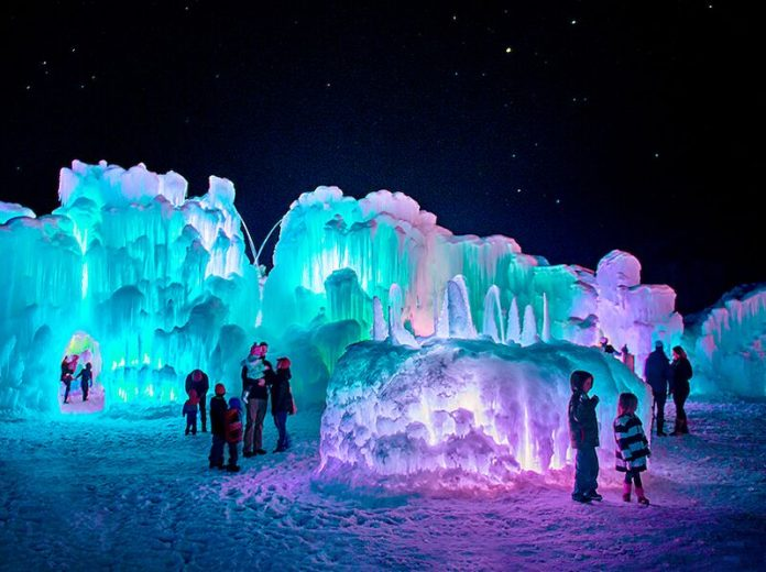 Families viewing the nearly 40-foot tall towers of Dillon Ice Castles