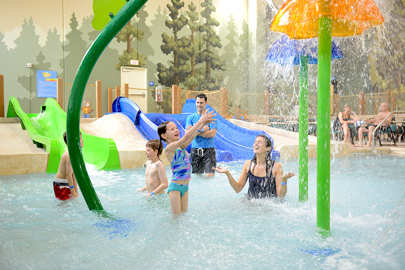 Kids and parents soaking up the fun under water spouts at the Great Wolf Lodge.