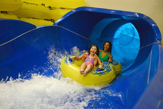 A family shooting down the waterslide at the Great Wolf Lodge.