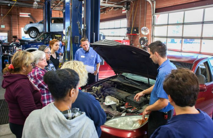 Women learning what's under the hood at Honest Accurate Auto Service's women's car care clinic in east Colorado Springs.