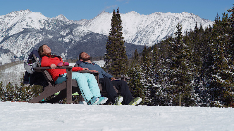 Skiers basking in the sun at Vail Ski Resort.