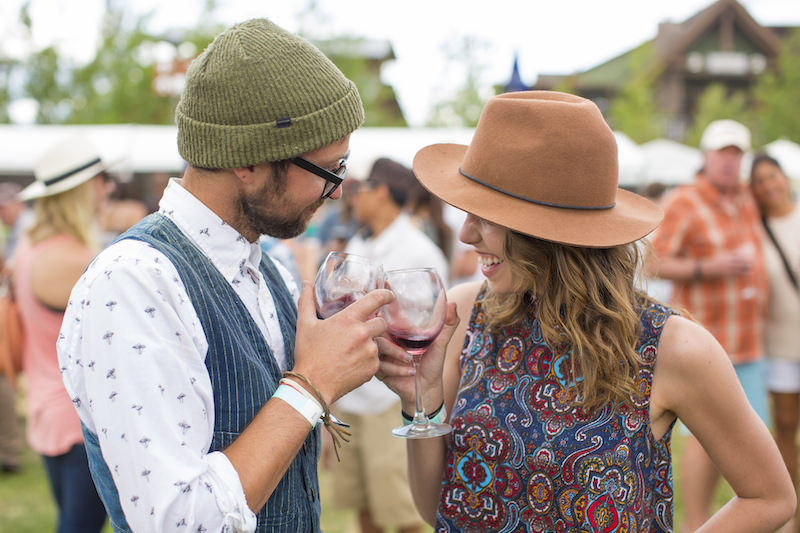 couple toasting wine at heritage fire