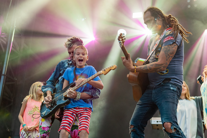 michael franti and kids on stage at jazz aspen snowmass festival