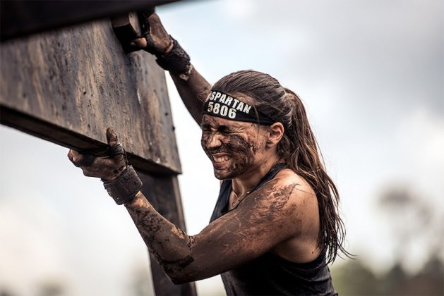 muddy woman at obstacles course races