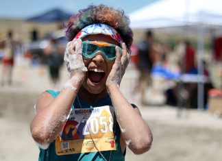 More the Muddier: Runners get down and dirty in the Big Dog Brag race.