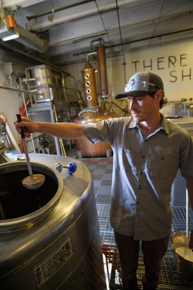 Sam Poirier preps yeast at Laws Whiskey House