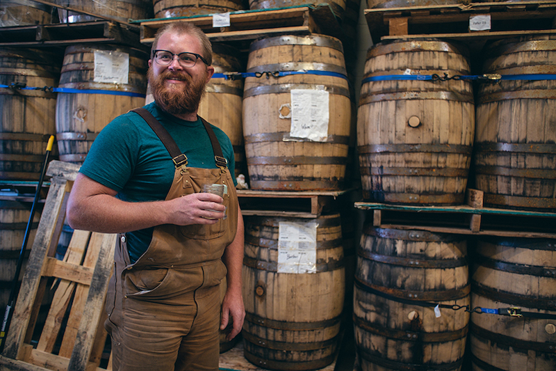Joel Randall and barrels of State 38 Distilling blue agave spirits on the Colorado Spirits Trail