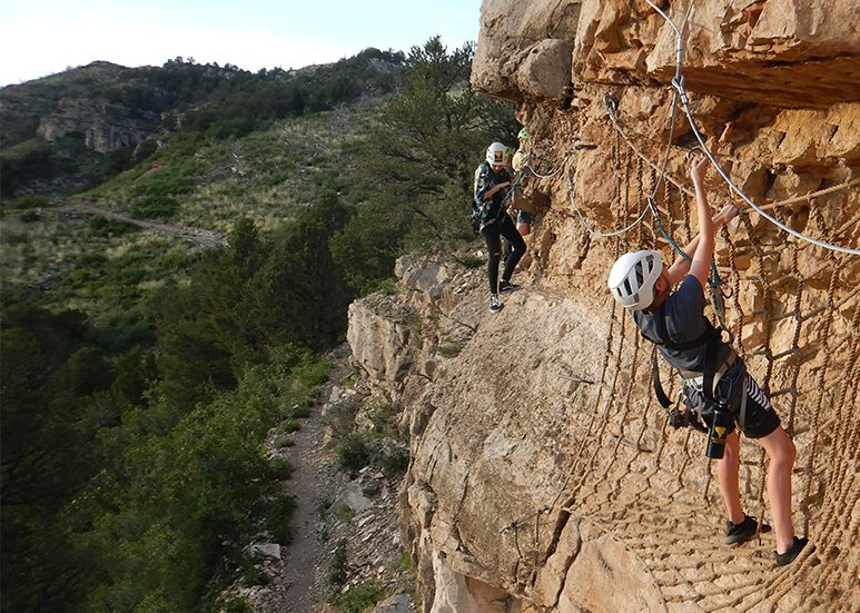 crossing the Cave of the Winds via ferrata cargo net