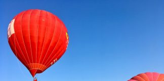 Hot air balloons launch with Pikes Peak on the horizon