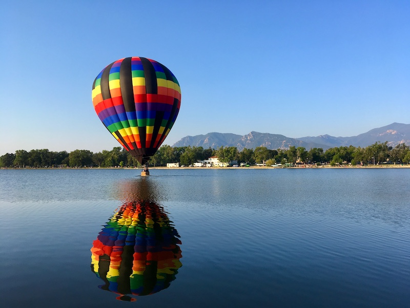 Hot air balloon touches down on Prospect Lake at the Colorado Springs Labor Day Lift Off