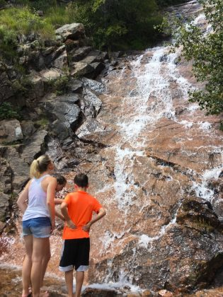 Cooling off at the base of St. Mary's Falls