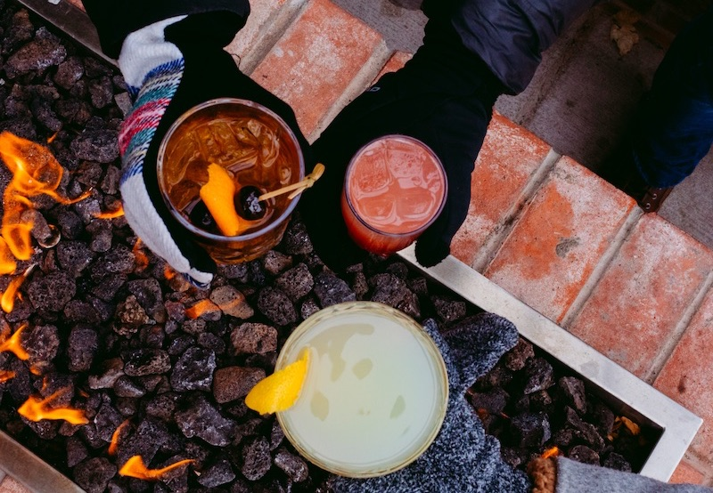 Cocktails by the outdoor fire at local restaurants in Colorado Springs