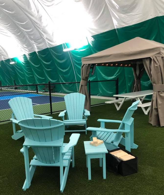 Cabanas inside the pickleball dome at North Side Social provide fun and games along with outdoor dining.