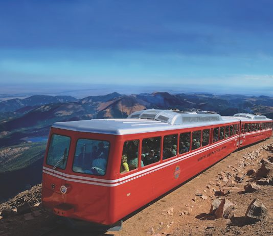 The Broadmoor, Manitou & Pikes Peak Cog Railway train on Pikes Peak. The iconic railway reopens in May, 2021.