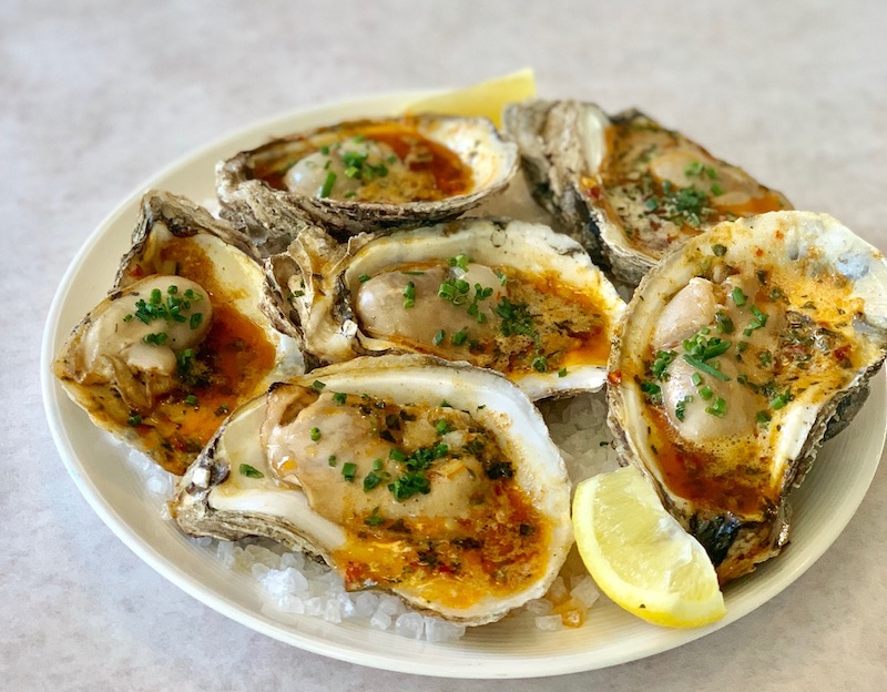 Nola style chargrilled oysters at Jax Fish House