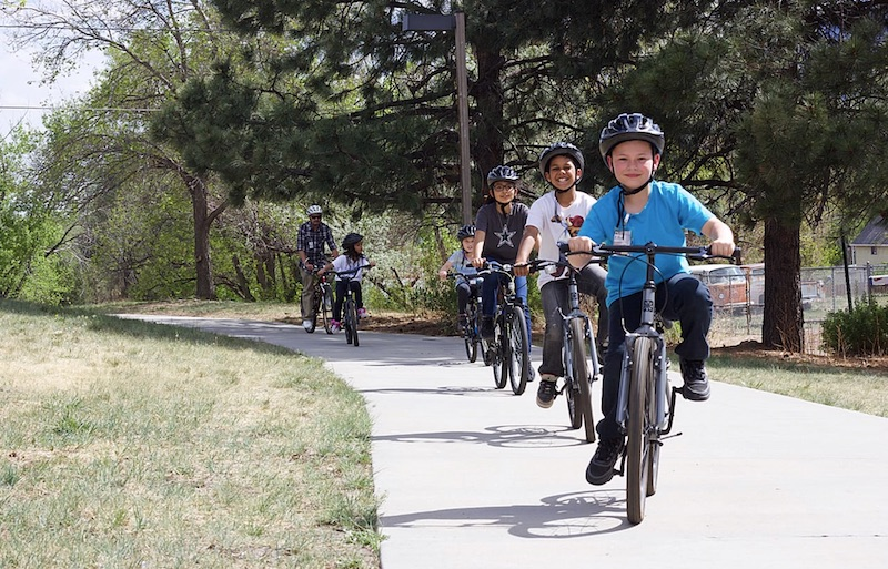 Kids ride bikes on paved path in Colorado Springs