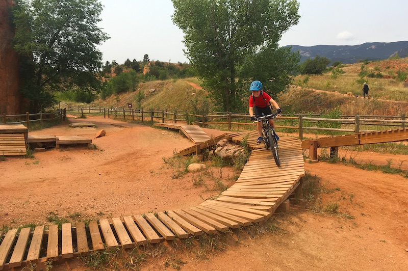 Learning to mountain bike in the Red Rocks Canyon Open Space skills park