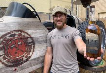 Axe and the Oak founder Casey Ross holds a bottle of The First Stake Bourbon to commemorate the Colorado Springs Sesquicentennial