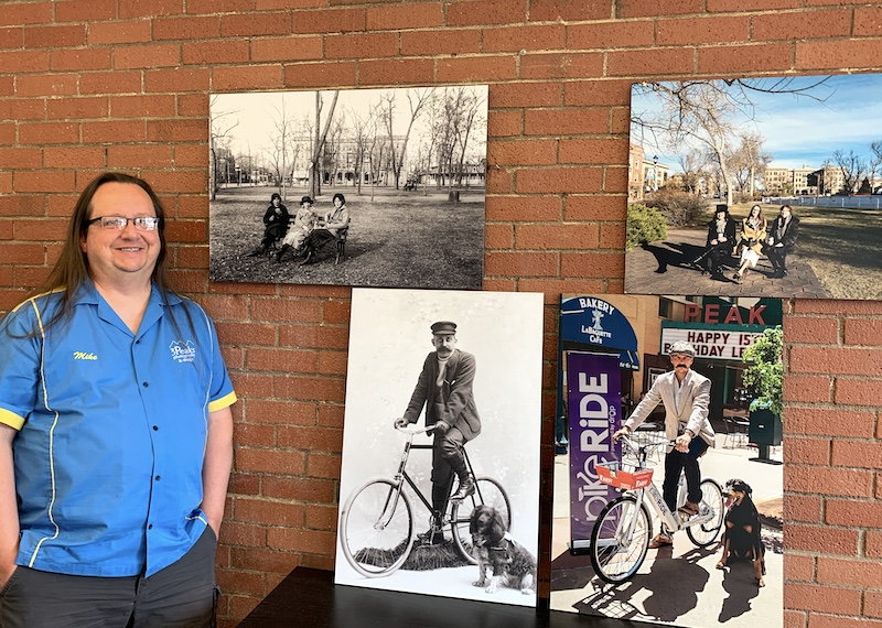 Mike Pach with photos from his COS150 Then and Now photography exhibit