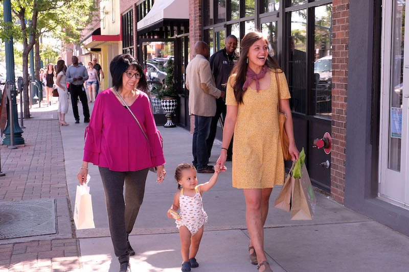 mom, grandmother and toddler shop on Tejon Street in downtown Colorado Springs