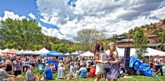 Dancing to the live music at the Manitou Springs Colorado Wine Festival with wineries in the backdrop