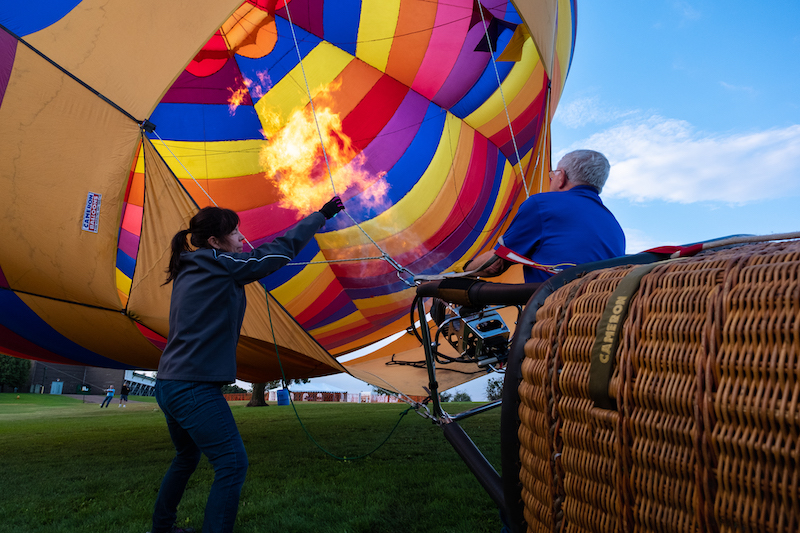 Rita Helak and Ray Bair prepare Kaleidoscope for launch ahead of the Labor Day Lift Off in Colorado Springs.