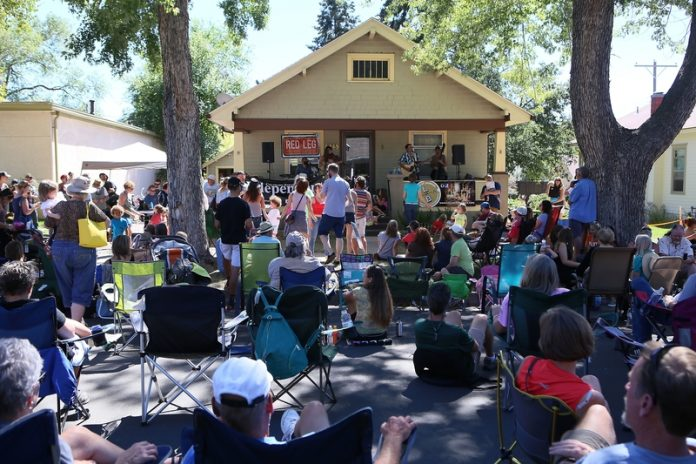 Porchfest crowd enjoying some live music at the block party