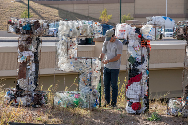 Filling giant letters with trash for Arts Month Litter Letter Project in Colorado Springs
